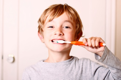 Owasso, OK boy brushing his teeth before visiting his Owasso dentist at Jillian Prather Family Dentistry.